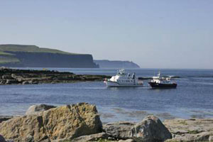 Doolin Ferries at low tide off Doolin Pier